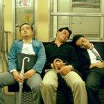 MEN ASLEEP ON A TRAIN TOKYO JAPAN
